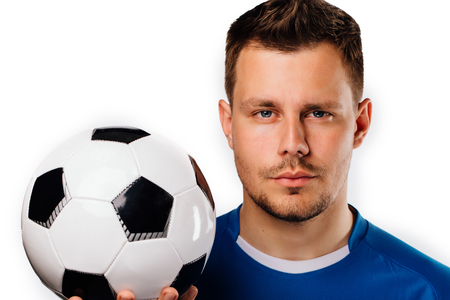 Close-up portrait of young handsome football player soccer posing on white isolated.