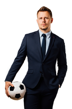young handsome businessman holding a football isolated on white background studio. Zdjęcie Seryjne