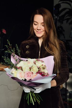 Woman holding flower bouquet