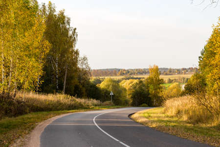 A two-lane road passing through a picturesque area. A sharp right turn on the road