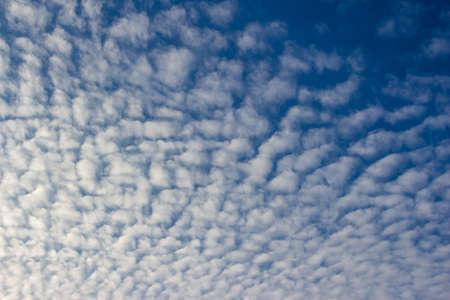View of white Altocumulus cloud against a blue sky