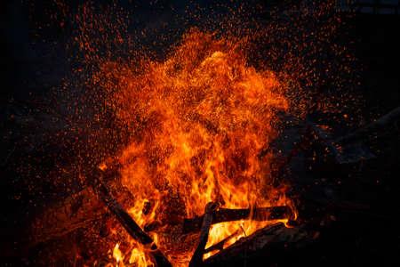 Billion rising sparks from a powerful bonfire, colorful space effect Banco de Imagens
