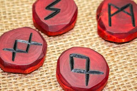 Scandinavian carved wood runes on burlap Imagens