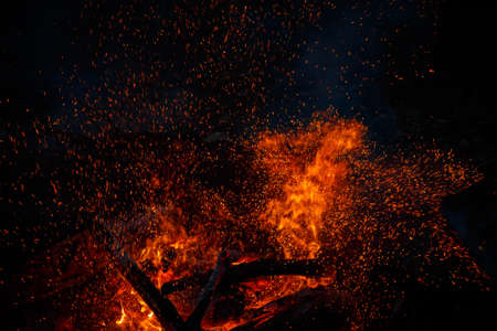 Campfire flame with sparks flying up at night Banco de Imagens