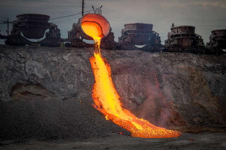 Discharge of metallurgical slag from blast furnaces. Beautiful stream of hot slag Reklamní fotografie