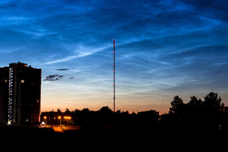 Noctilucent clouds (night shining clouds) in the night sky over the city. July 2020 - Obninsk, Russia Stok Fotoğraf