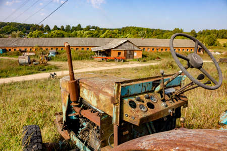 old Soviet tractor LTZ - Lipetsk tractor plant. Farm in the countryside