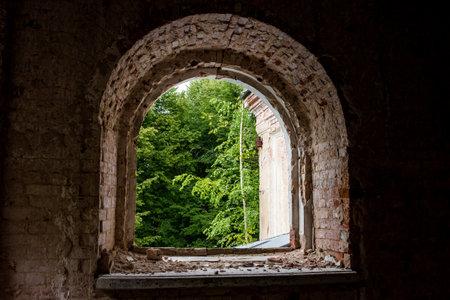 View from the window of an old house. Abandoned old house. Manor Stepanovskoe-Pavlishchevo 19th century. Pavlishchev-Bor, Kaluzhskiy region, Russia Stock fotó