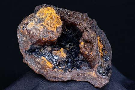 Goethite geode in limonite on a dark background. Deposit Russia