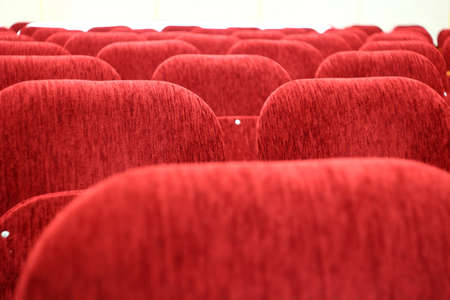 The backs of the red chairs in the auditorium, empty hall Stock fotó