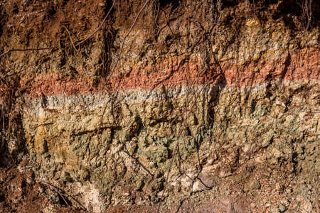 Clay layer folded in layers of different colors dried in the sun