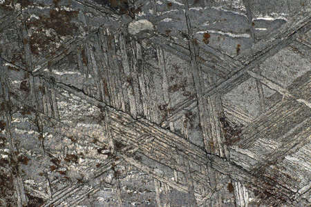 The surface of the Muonionalusta meteorite etched in acid with the Widmanstetten patterns macro