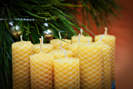 beeswax candle: romantic candles from natural wax with band made for holiday. Candle made of beeswax honeycomb.