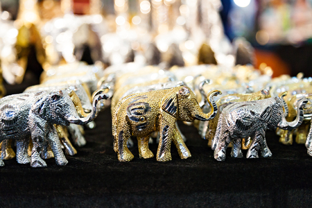 souvenir traditional: souvenir shiny elephant on the market in India. Traditional symbols of India. Buddhism