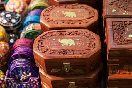 inlaid: Traditional casket of rosewood inlaid with brass and carved in the Indian market. Casket with elephant is handmade in India.