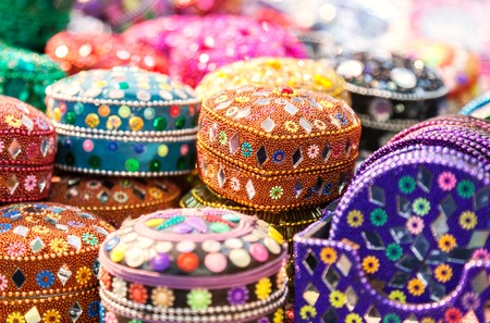 jewel case: Handmade.  Various different colorful casket in the Indian market. Casket decorated with sequins, sequins and beads Stock Photo