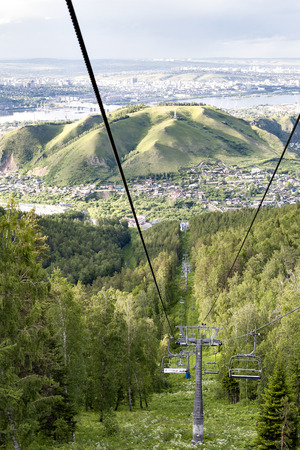 chairlift: Russia. Cableway beautiful summer day in Krasnoyarsk. lift chairs, cableway funicular chair equipment, chairlift