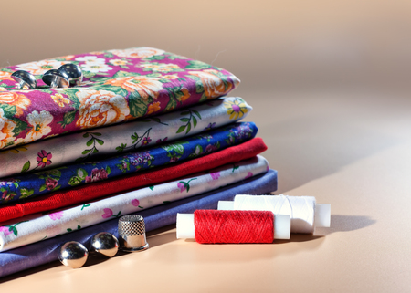 cotton fabric: Tools for sewing. Sewing workshop. Different colored fabric. Organic cotton and calico. Needlework.