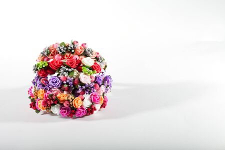 artificial hair: a bouquet of flowers isolated on white background, artificial flowers, hair ornaments made of artificial flowers. hair band