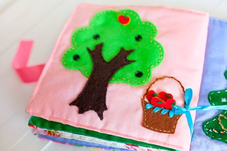 motility: Soft logical manual book for children. Pages books for the mind growth and motility. Touch handmade book for young children Stock Photo