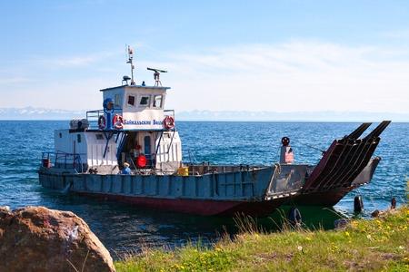 listvyanka: ferry Baikal water at Lake Baikal Siberia, Russia. 06112013 Port Baikal, Listvyanka. Water transport . Blue sky and water on a summer day.