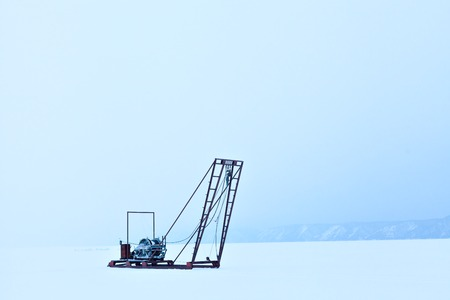 listvyanka: The study of the sun, the solar activity and earthquakes, seismic activity. Winch for the study of ice outdoors during the winter on the lake Baikal. Russia Siberia. Science and research station.