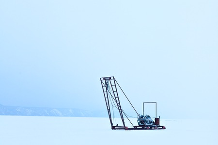 listvyanka: Winch for the study of ice outdoors during the winter. Russia Siberia. Science and research station on Lake Baikal. The study of the sun, the solar activity and earthquakes, seismic activity.