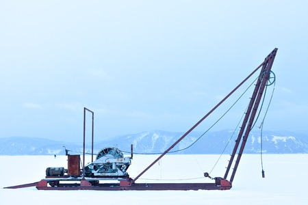 listvyanka: Winch for the study of ice outdoors during the winter. Russia Siberia.  The study of the sun, the solar activity and earthquakes, seismic activity. Science and research station on Lake Baikal. Stock Photo