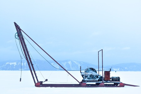 listvyanka: Russia Siberia. Winch for the study of ice outdoors during the winter. Science and research station on Lake Baikal. The study of the sun, the solar activity and earthquakes, seismic activity.