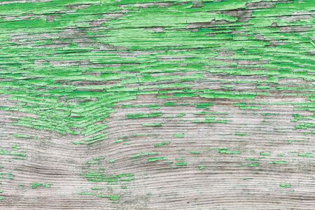 green ink: The surface with peeling old paint. Texture green ink as background