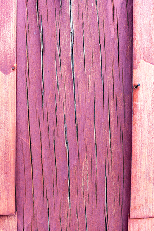 crevice: purple and violet wooden rustic background or painted wood boards texture. Cracks and crevices on the surface of the plywood. The frame and copy space. Stock Photo