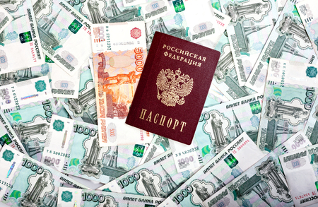 denomination: Money and Russian banknotes of denomination one and five thousand in the background. Passport of the Russian Federation Stock Photo