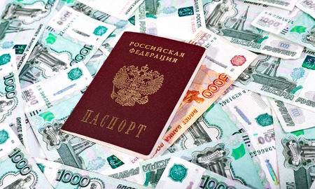 russian federation: Money and Russian banknotes of denomination one and five thousand in the background. Passport of the Russian Federation Stock Photo