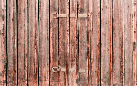 hinges: Wooden rustic background or painted wood boards texture. Boards with metal hinges. Old peeling paint. Old colored wooden boards as a background with copy space. Stock Photo