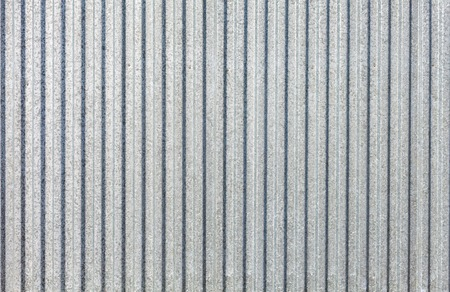 stainless steel sheet: new stainless steel sheet metal galvanized iron as a fence. Galvanized sheet - Corrugated metal surface texture with copy space.