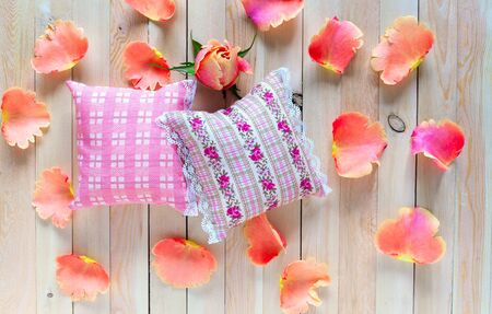 sachets: Small cotton pads with aromatic herbs and flowers. Delicate aroma sachets with lace on the wooden background. Rose petals and rosette for aromatherapy. Gift with a pleasant aroma.