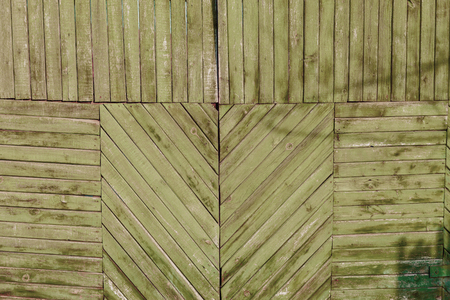 diagonally: Wooden boards as a background. The texture of the fence. Vintage effect. Wooden boards diagonally, vertically and horizontally. old peeling paint. Copy space.