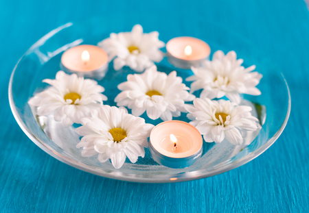 aroma bowl: Aroma Bowl with floating candles and flowers. Stock Photo