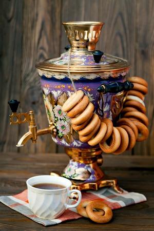 samovar: Still life with fragrant fresh tea as a delicious bagels and a large samovar