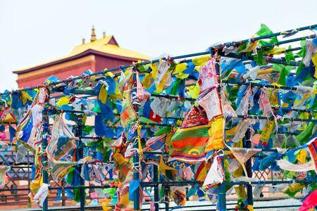 buryatia: Prayer flags and Hadak at sunset in the Republic of Buryatia. Datsan Rinpoche Bagsha on Bald Mountain in Ulan-Ude, Russia.