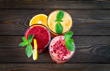 Fresh Fruit Smoothies. Assorted fruit smoothies on a wooden table. smoothie concept