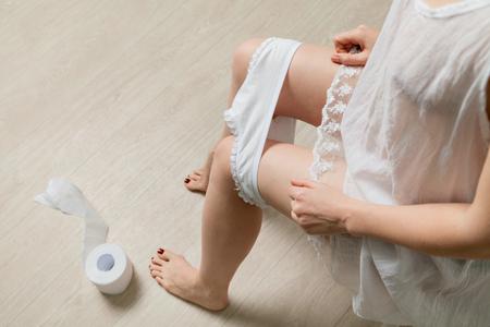 Female holding females hygiene means