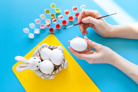 Person painting Easter eggs Stock Photo