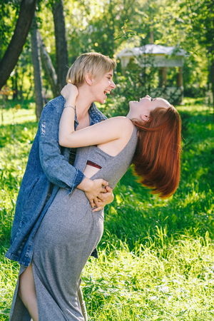 alternative couple hugs and laughs