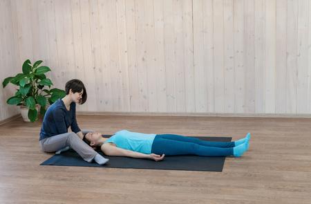 Trainer having physical psychotherapy with patient woman