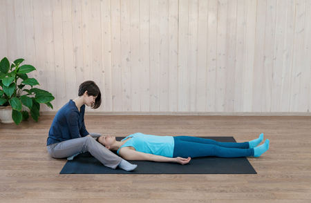 Trainer having physical psychotherapy with patient and