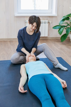 Woman practicing special psychotherapy with trainer
