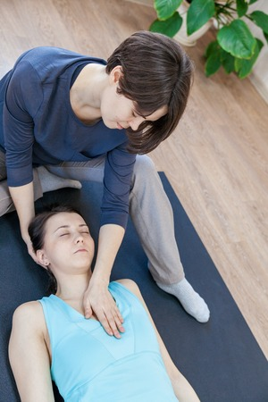 Trainer doing special therapy with physical contact Stock Photo