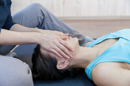 Crop woman conducting psychotherapy with body contact