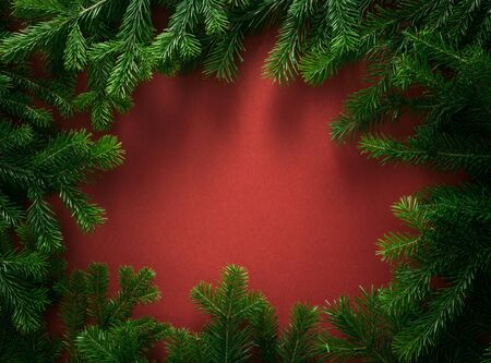 Christmas composition. frame of spruce branches, on a red background. Christmas, winter, new year concept. Flat lay, top view, copy space Standard-Bild - 133241756